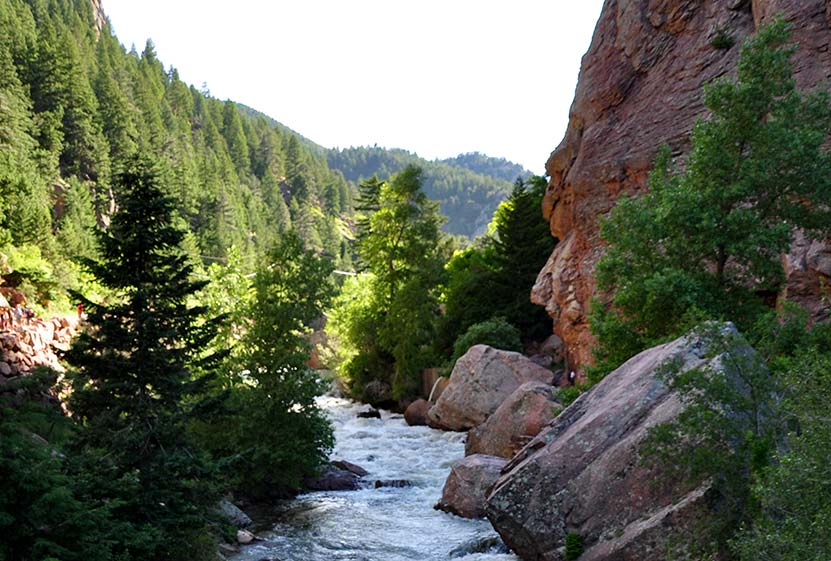 boulder creek flowing below orange cliff faces of eldorado canyon