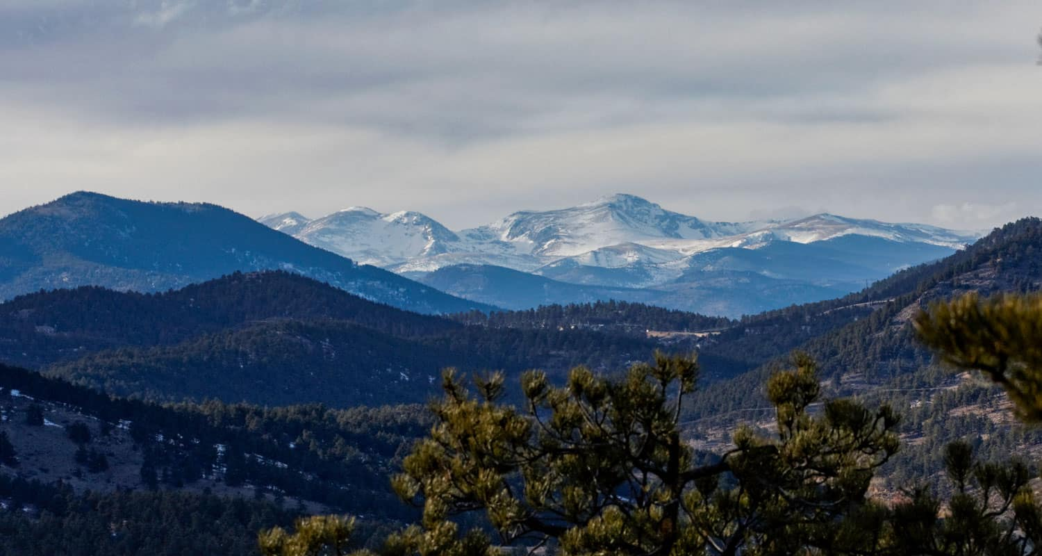 view to the western rocky mountain from panorama point in corwina park hike near denver