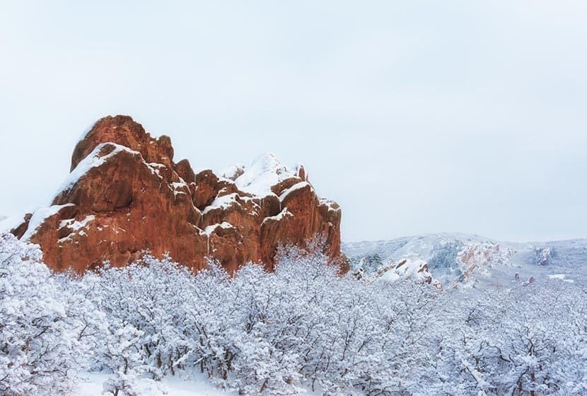 red rocks and snow along hiking trail at roxborough state park in colorado winter hikes near denver