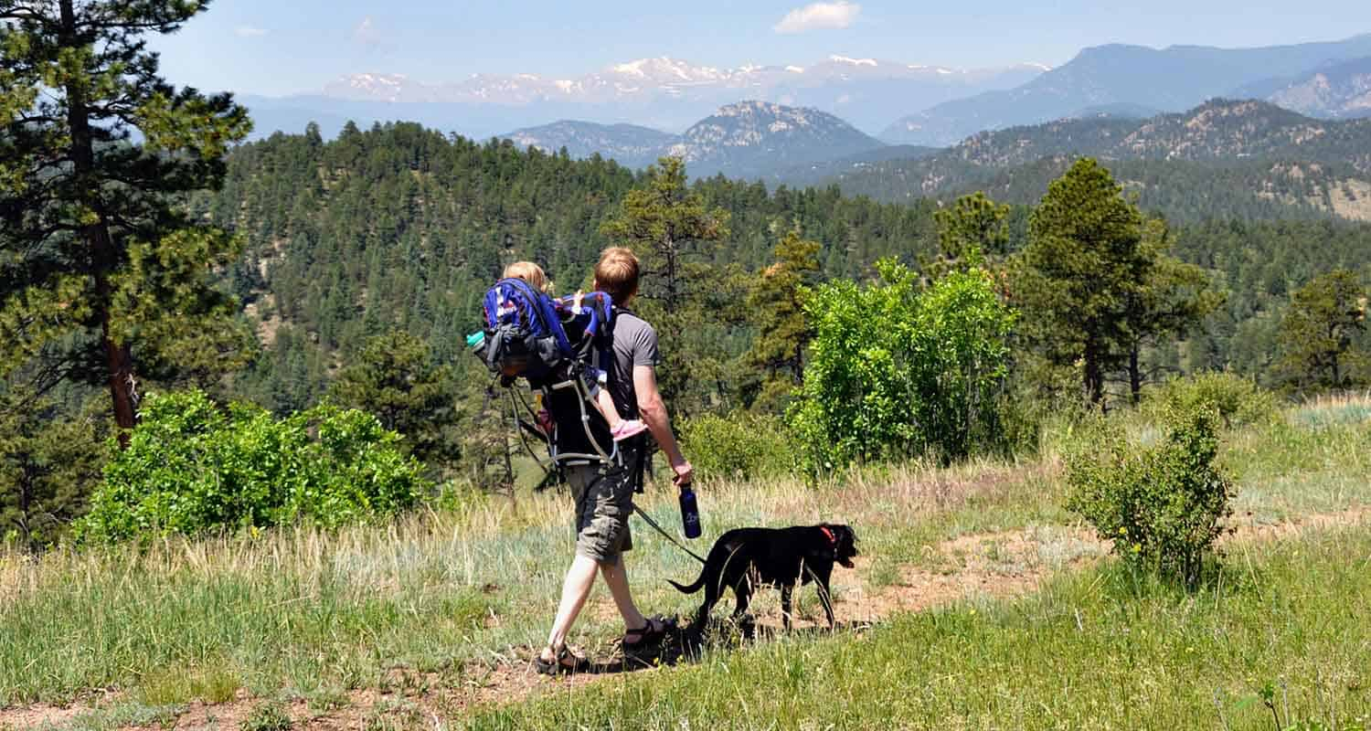 Man with child and dog on Dog Friendly Hikes Near Denver
