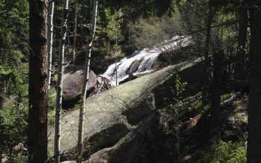 buffalo creek waterfall at wellington lake slide waterfall cascading over granite slab on hike near denver