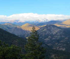 view to snowcapped peaks realization point in boulder colorado