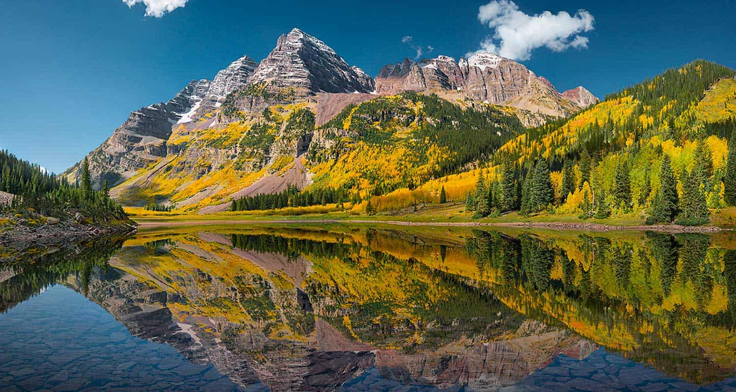 maroon bells in fall reflected in crater lake best hikes when visiting colorado