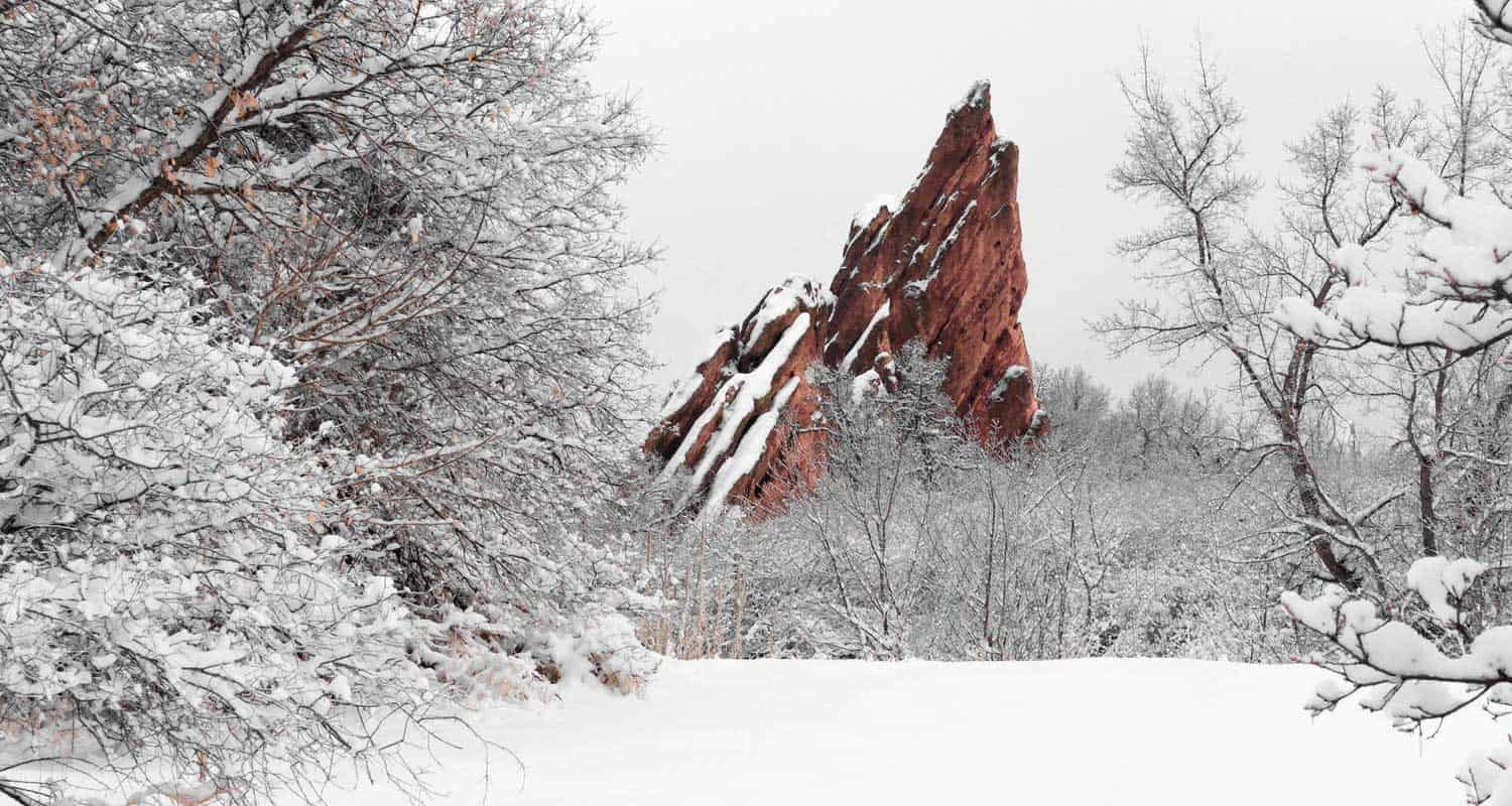 red rock tower in snow at roxborough state park in colorado best winter hikes near denver