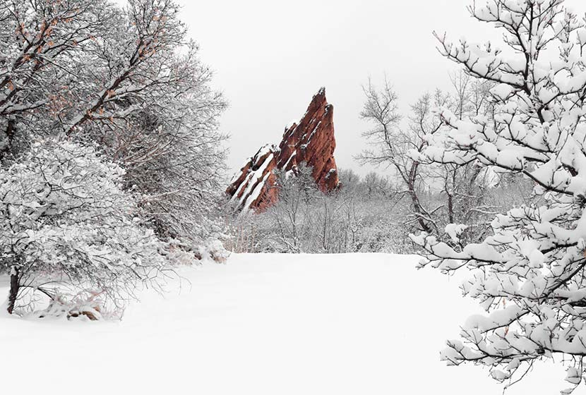 red rock formation in snow at roxborough state park colorado winter hike