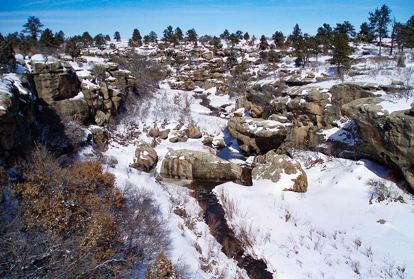 cherry creek flowing through winter landscape of castlewood canyon winter hike near denver