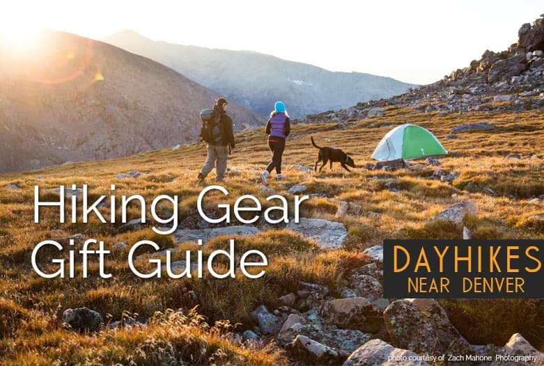 backpackers in colorado mountains with tent