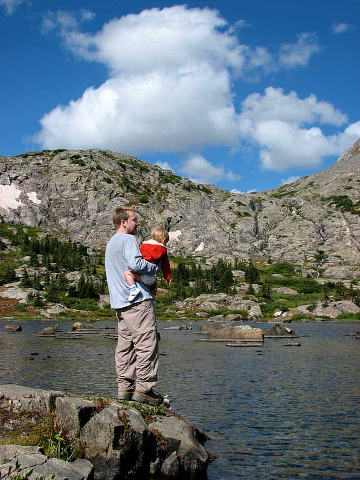 hiker with child at lower mohawk lake in Colorado mountains