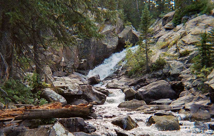 waterfall through rocks of middle boulder creek near lost lake in indian peaks wilderness