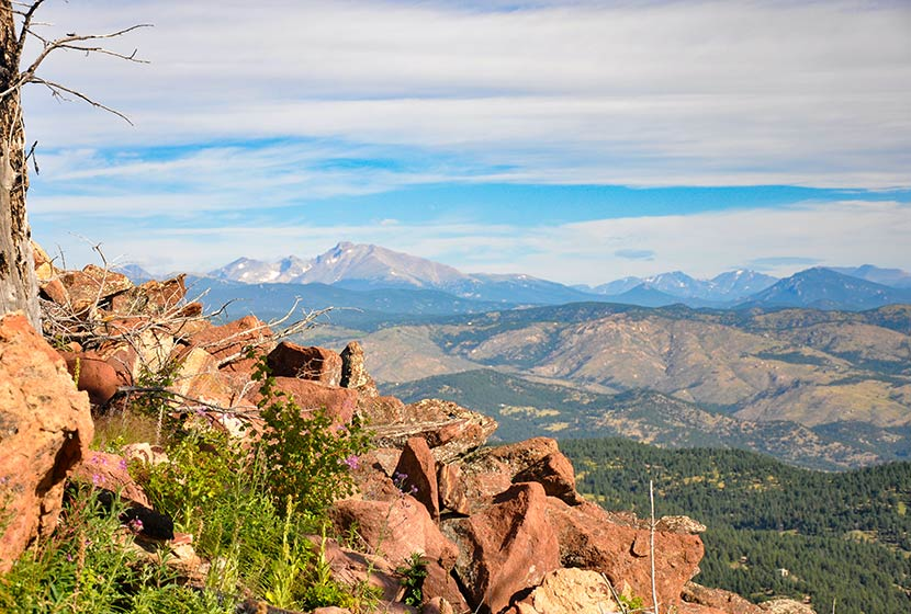 view along approach to south boulder peak summit to the Northwest with Longs Peak mountain in distance