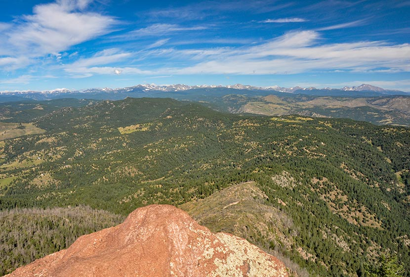 view out to front range mountains near indian peaks from the summit of South boulder peak