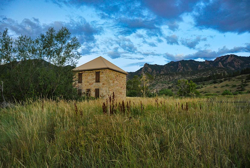 old stone building along south mesa homestead trail on hike to bear creek