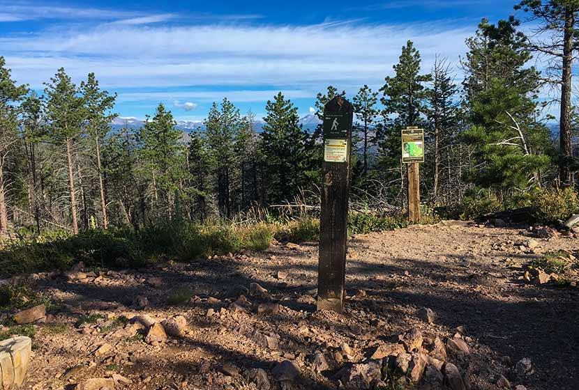 sign for trail split on saddle between bear peak and south boulder peak