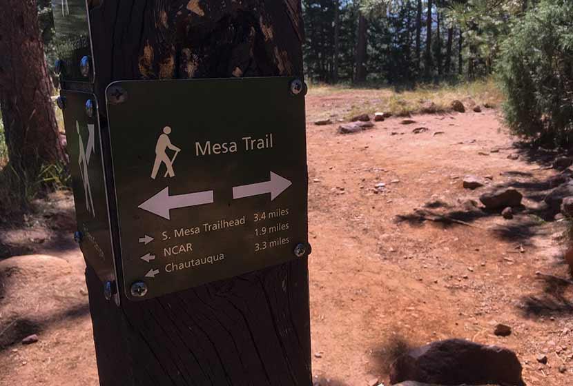 mesa trailhead sign below flatirons near boulder colorado