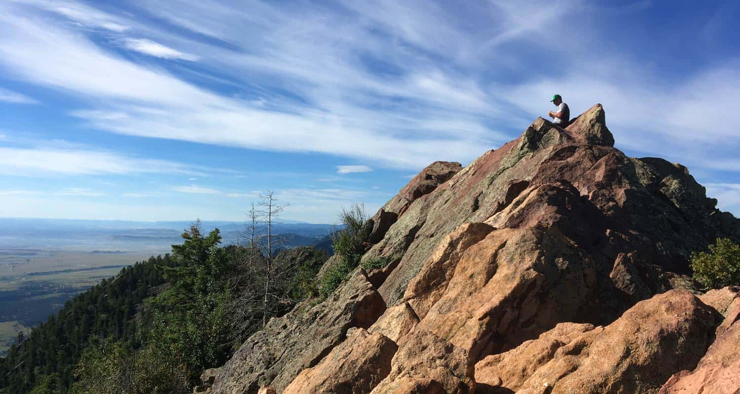 Hiker on summit of bear peak near boulder colorado