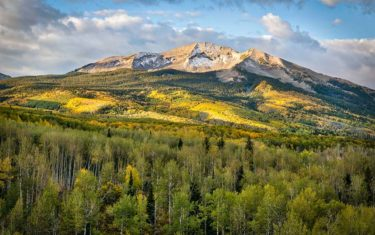 kebler pass with golden aspen trees and grey mountain in background courtesy of Kevin Wenning