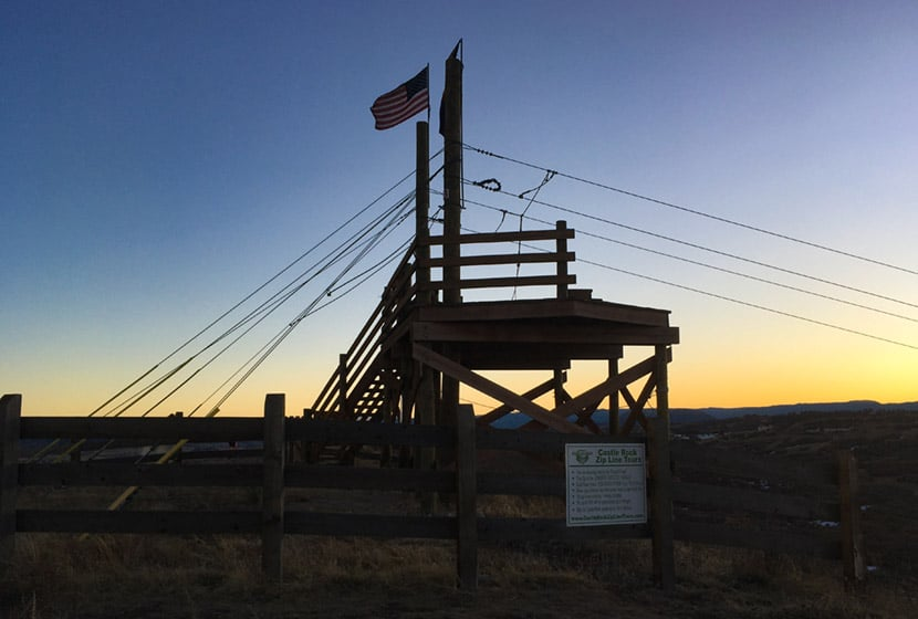 castle rock challenge hill at top of promontory zipline platform at dusk