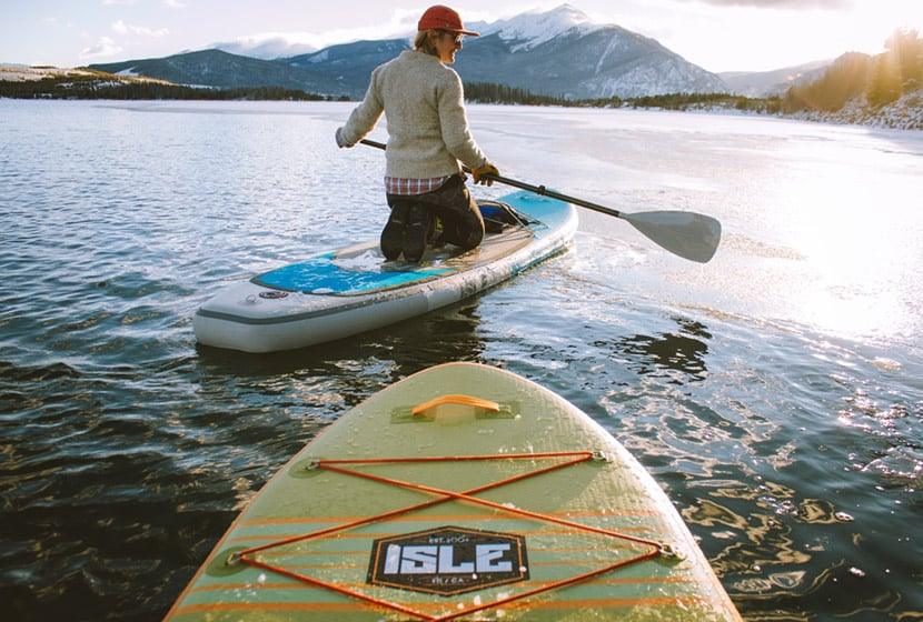 paddleboarder on colorado lake by colorado adventure photographer holly mandarich