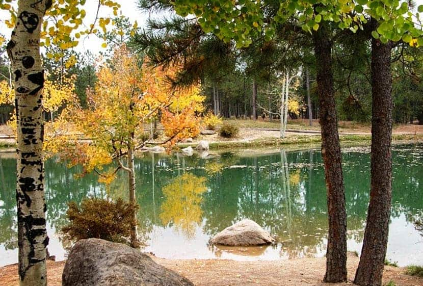 green lake with changing aspens at fox run park near colorado springs at beginning of the fallen timbers loop hike