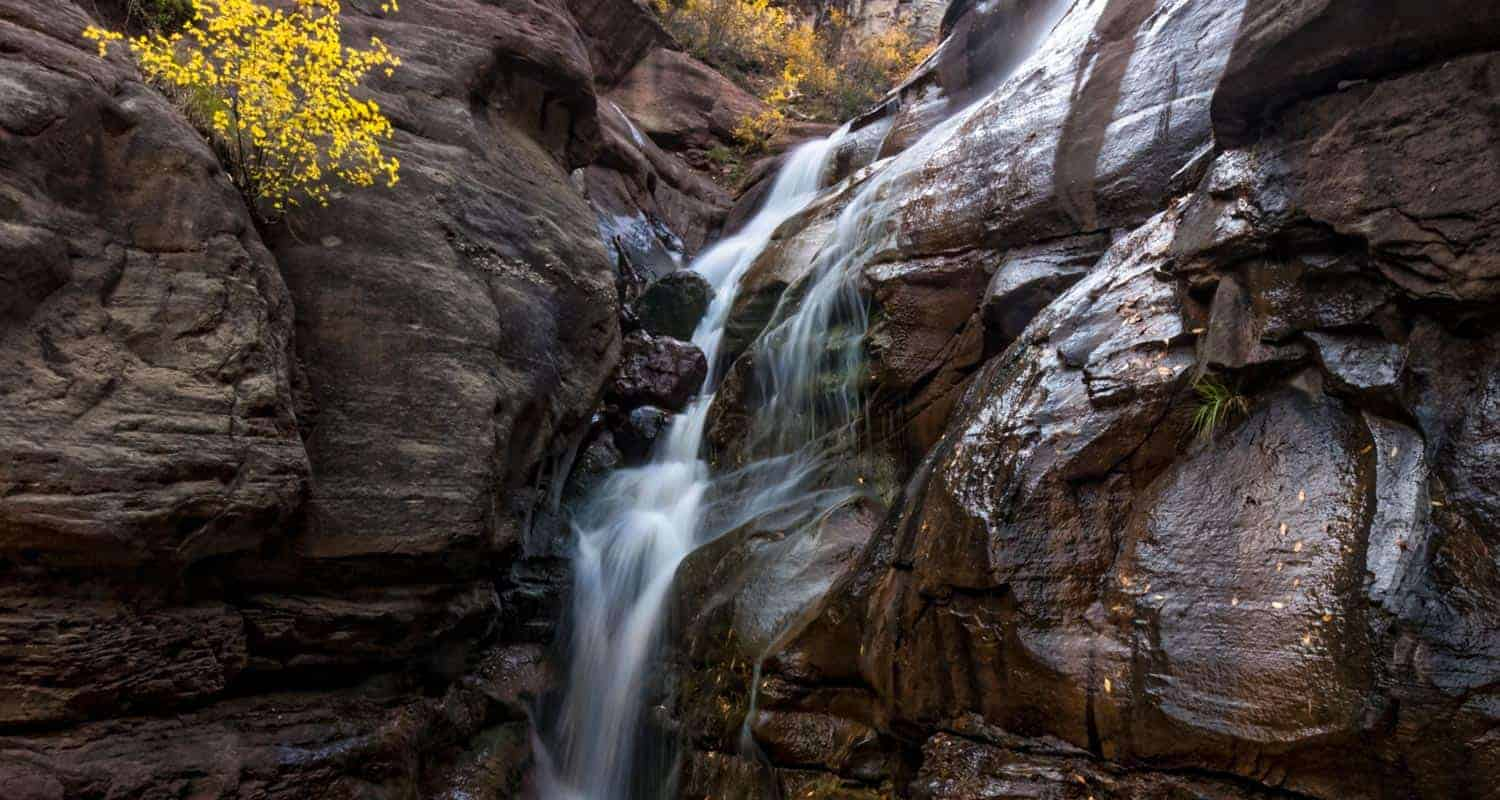 hays creek waterfall cascading over red granitic sandstone near carbondale colorado