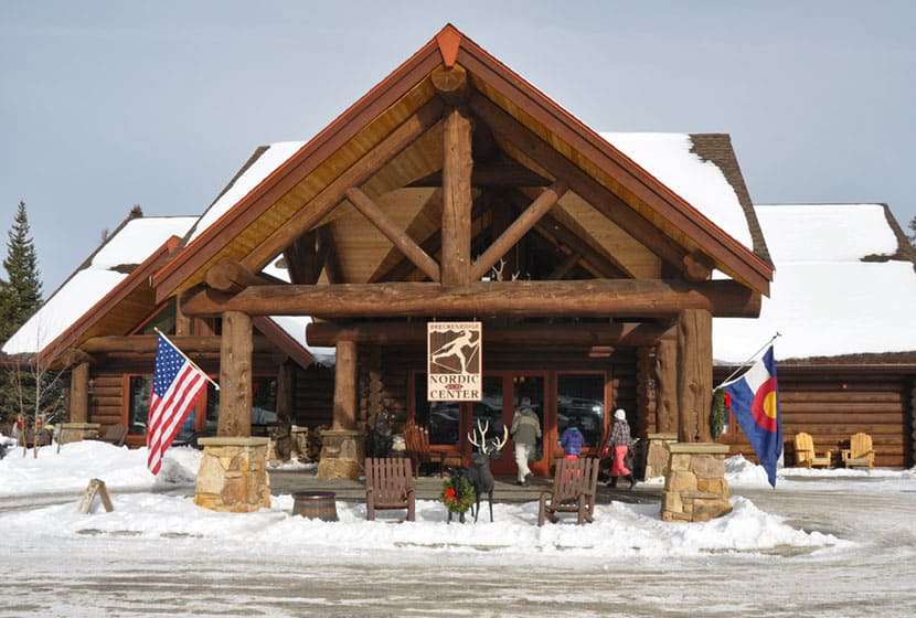 front of breckenridge nordic center lodge with snow