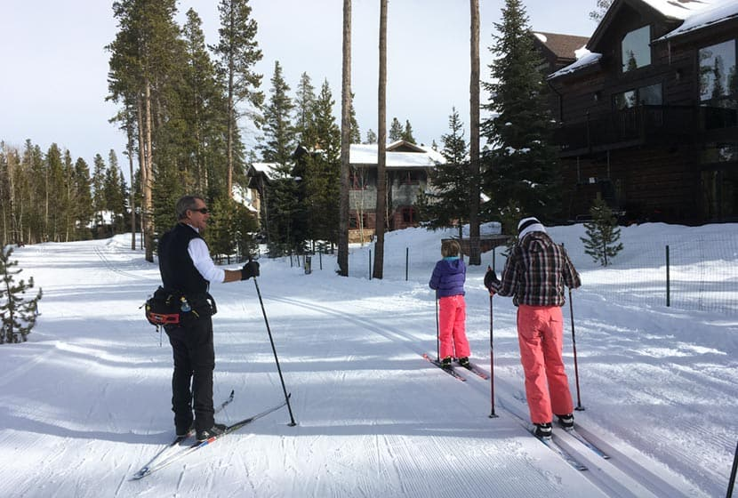 two children taking cross country ski lesson with gary at breckenridge nordic center in colorado