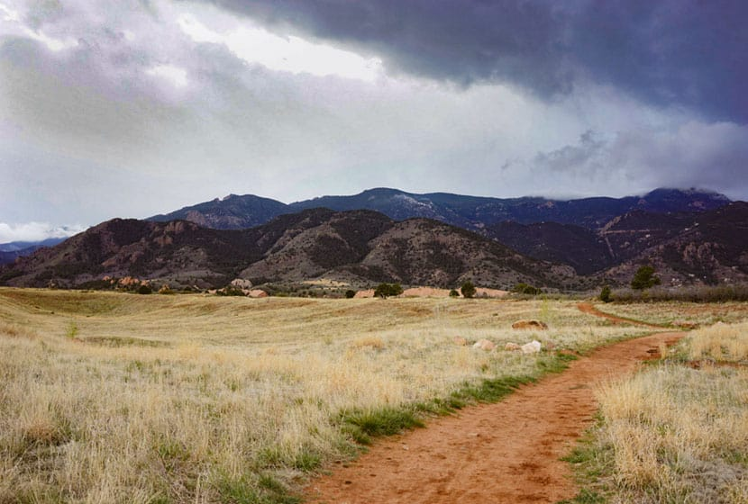 dirt trail leading toward foothills south of red rock open space on hike in colorado springs
