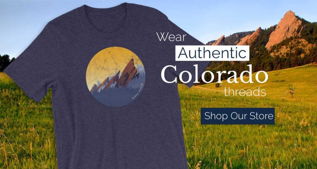 tshirt in blue midnight heather color with flatirons and words wear authentic colorado threads shop our store overlay text on image