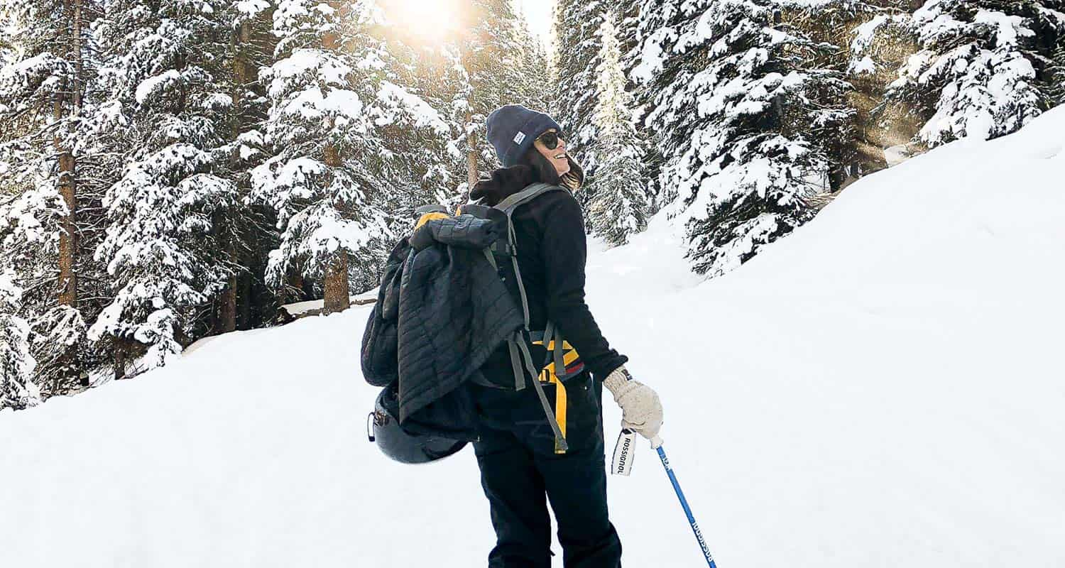 woman hiker hiking on snow tips for hiking muddy trails