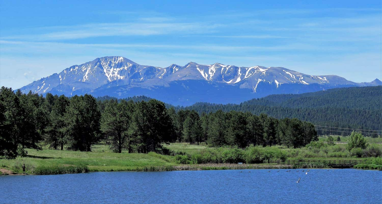 manitou lake near colorado springs with pikes peak in the background along hike
