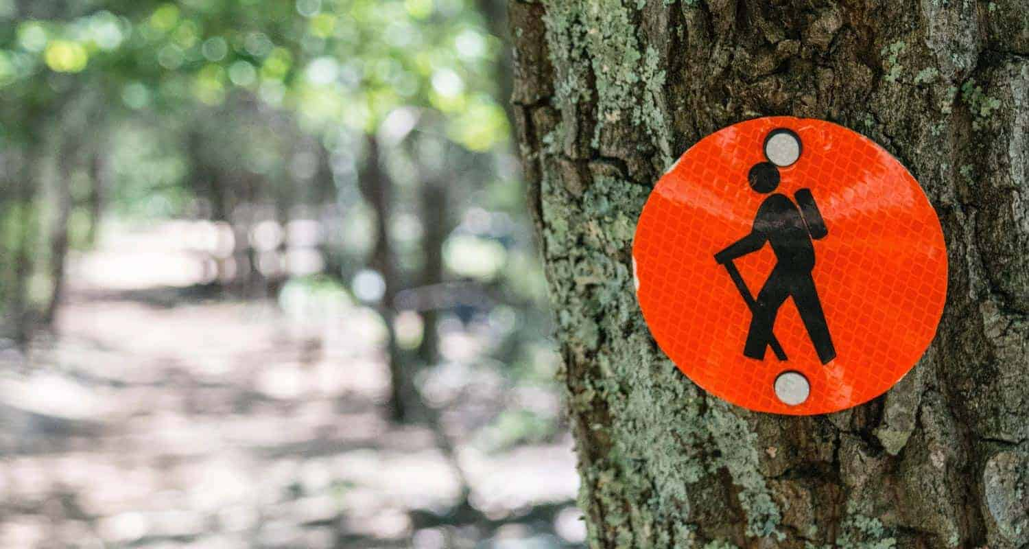denver area trail closures red hiking blaze on tree alongside trail
