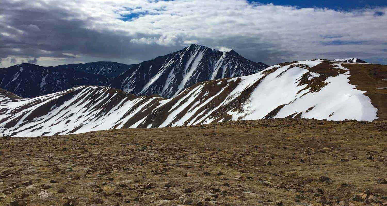grizzly peak mountain in colorado with clouds and high country tundra landscape