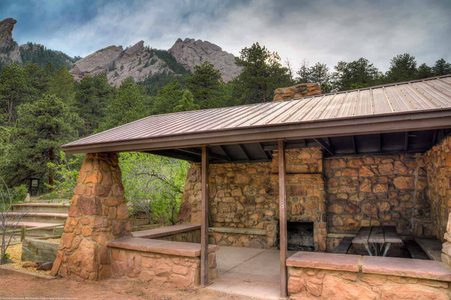 shelter along the bluebell road trail in chautauqua park boulder with flatirons in background